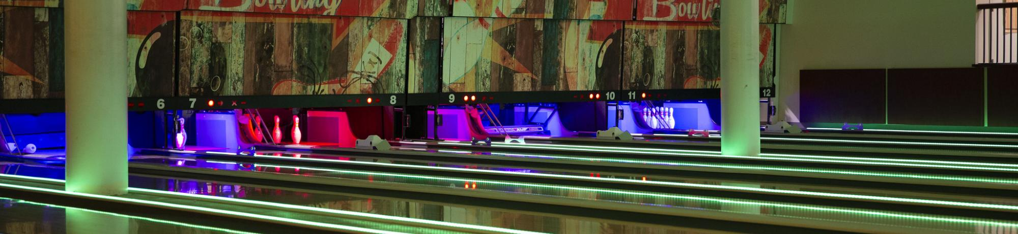 the games area bowling alley lanes with colorful led lights